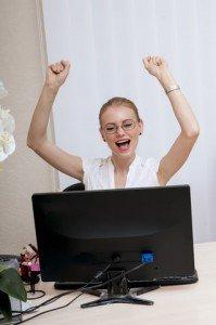 Woman Celebrating at Desk