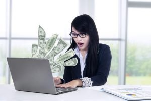 Money coming through computer thanks to email marketing strategy