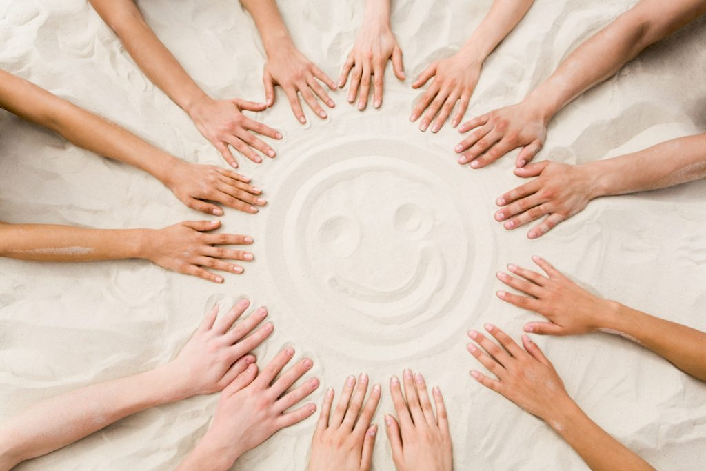 Hands in the sand - together - creates happinessy